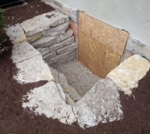 Egress Window Dug and Lined with Stone